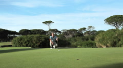 Mature man playing golf on golf course Stock Footage