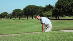 Mature man in sand trap on golf course Stock Footage