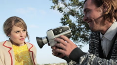 Man filming girlfriend blowing bubble gum Stock Footage