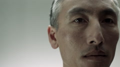 Close up of mature Chinese man - stock footage