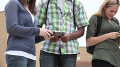 High school students using smartphones Stock Footage