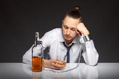 Alcohol dependence in men - stock photo