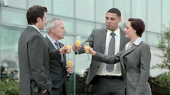 Stock Video Footage of Businesspeople outdoors, toasting with bucks fizz