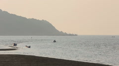 Misty tropical seascape with boats and fishermen silhouettes - stock footage