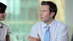 Businesspeople talking in meeting - stock footage