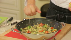 Asian stewed wegetables in a wok Stock Footage