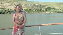 Senior couple embracing on a boat holiday Stock Footage