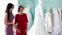 Mother and daughter looking at wedding dress Arkistovideo