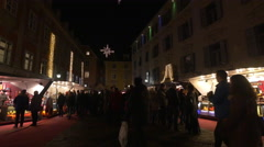 People gathered at the Christmas market in Mehlplatz, Graz Stock Footage