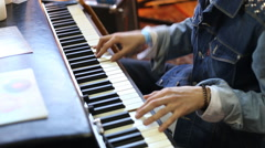 Stock Video Footage of Close up of hands playing a piano