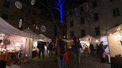 Tourists visiting the Christmas market in Färberplatz, Graz Stock Footage