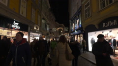 Walking by Supper Willy and Raffeli stores on Christmas in Graz - stock footage