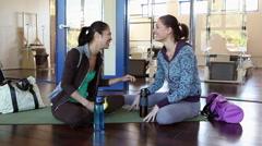 Two women talking in gym Stock Footage