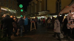 Relaxing at the Franziskanerviertel Christmas market in Graz Stock Footage