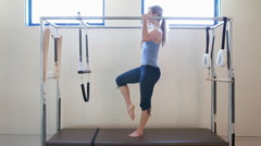Young woman doing pilates Stock Footage