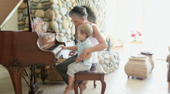 Grandmother and grandson playing piano Stock Footage