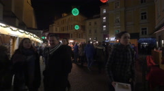 People visiting the Franziskanerviertel Christmas market in Graz Stock Footage