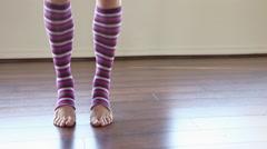 Woman wearing striped leg warmers in pilates studio Stock Footage