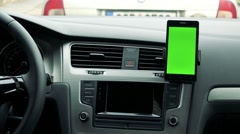Dashboard - radio (navigation) touch screen in the modern car - green screen  Stock Footage