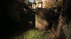 Tilt up across headstone in Circular Church cemetery-Charleston Stock Footage