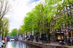 Amstel river with canal and building facades Stock Photos