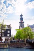 Beautiful view of Amsterdam over canal and church - stock photo