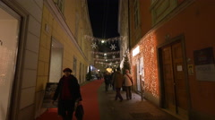 Walking by Fielmann, Vogue and Gressl stores on Christmas in Graz - stock footage