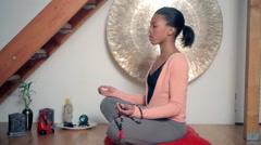 Women sitting in lotus position - stock footage