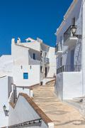 Traditional Andalusian white houses under blue sky Stock Photos