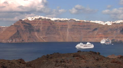 Cliffs of the Santorini island - camera pan from the volcano. Stock Footage