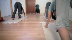 Women practicing yoga with instructor Stock Footage