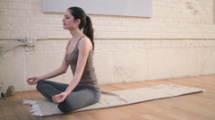 Young woman in lotus position Stock Footage