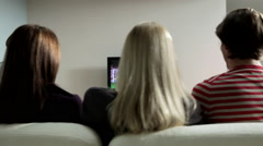 Two couples watching football on television Arkistovideo