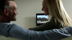 Couple watching television Stock Footage