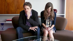 Couple sitting on sofa arguing - stock footage