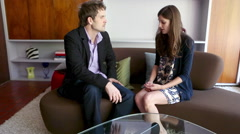 Couple arguing on sofa - stock footage