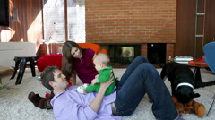 Stock Video Footage of Parents playing with baby son in living room