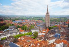 Cityscape with church of Our Lady Bruges top view - stock photo
