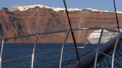 Sailing towards the red cliffs of Santorini with it's capital - Fira, on top. Stock Footage