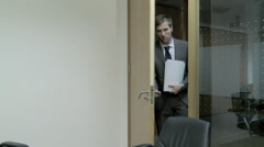 Businessman entering meeting room Stock Footage