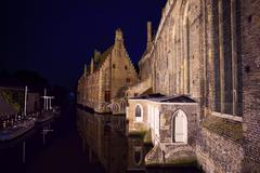 Sint-Janshospitaal from river at night, Bruges - stock photo