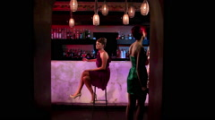 Woman sitting at cocktail bar Stock Footage