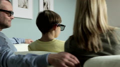 Family watching 3D movie at home Stock Footage