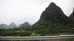 Stock Video Footage of China, yangshuo, landscape viewed from moving transport