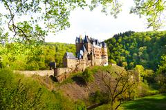 Side view of Eltz castle from the forest Stock Photos