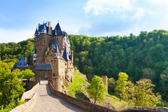 Road to the Eltz castle with towers, in hills Stock Photos