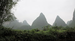 China, yangshuo, view of karst peaks from boat on yulong river Stock Footage