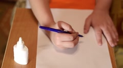The child draws the pen a fir-tree - stock footage