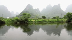 China, yangshuo, yulong river and landscape viewed from boat Stock Footage