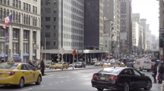Cars driving in traffic on Park Ave during day in winter, NYC Stock Footage